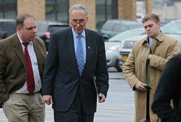U.S. Senator Charles Schumer, center, arrives to a press conference in front of TJ Maxx to urge the Federal Emergency Management Agency (FEMA) to examine the outdated flood maps that have incorrectly placed the Johnstown Shopping Center, as well as up to 50 other properties in the surrounding area, in the Cayudutta Creek's flood zone  on Friday, April 10, 2015 in Johnstown, N.Y. (Lori Van Buren / Times Union) Photo: Lori Van Buren / 00031385A