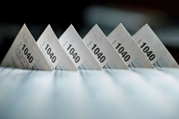 U.S. Department of the Treasury Internal Revenue Service (IRS) 1040 Individual Income Tax forms for the 2014 tax year are arranged for a photograph in Tiskilwa, Illinois, U.S., on Monday, March 16, 2015. The deadline for filing 2014 U.S. income taxes is Wednesday, April 15, 2015. Photographer:  Daniel Acker/Bloomberg