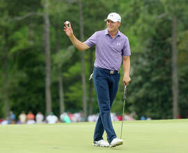 Jordan Spieth waves to the gallery on the 18th green after a 6-under par 66 during the second round of the Masters.