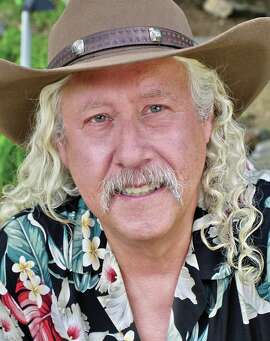 """Arlo Guthrie has turned """"Alice's Restaurant"""" into a multimedia event with lights, videos, film clips and archived photographs for the 50th anniversary tour of the antiwar song and album."""
