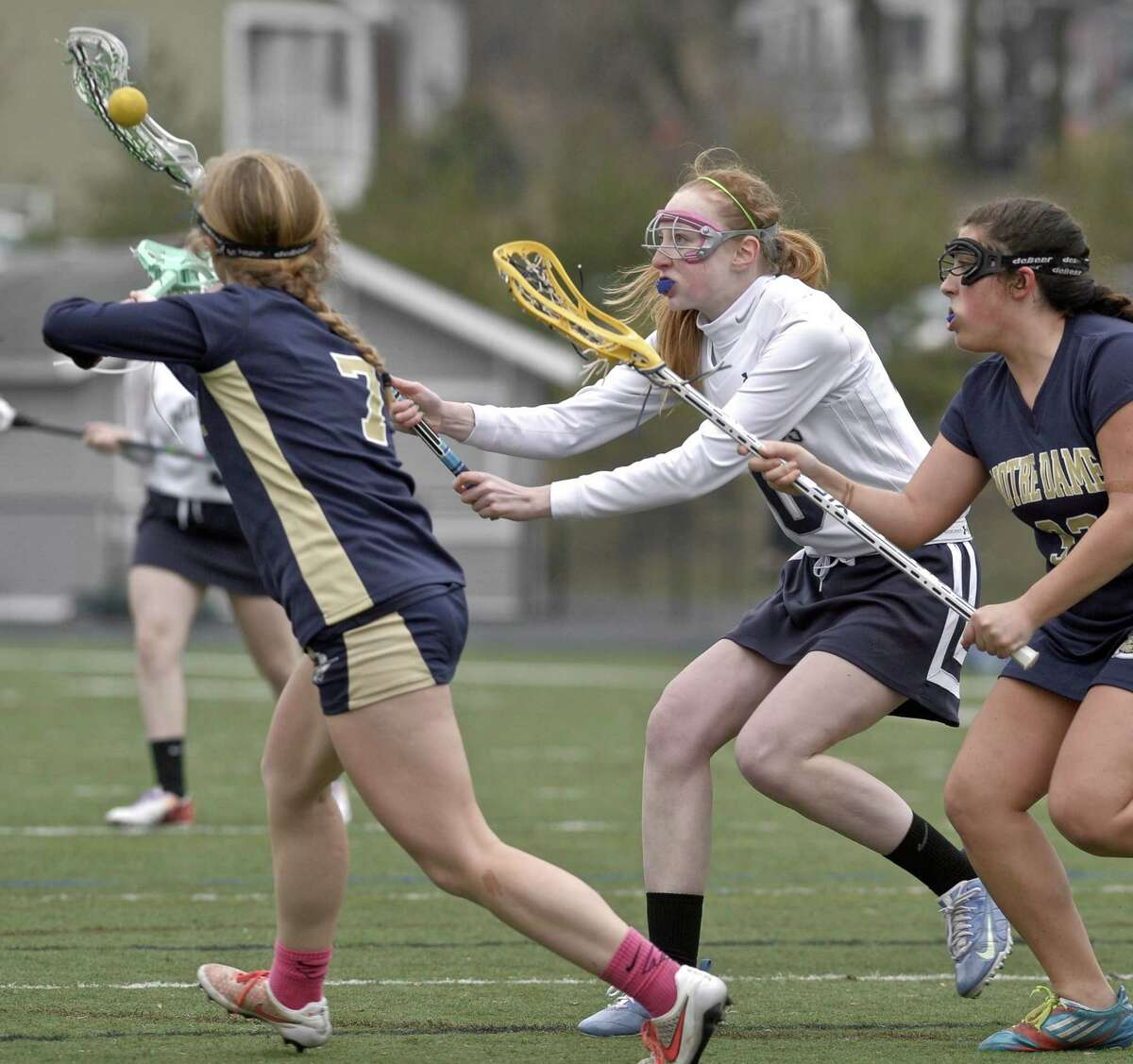 Immaculate's Kara Wakefield (10) goes for the ball between Notre Dame's Delaney O'Keefe (7) and Alicia Berard during the girls high school lacrosse game between Notre Dame-Fairfield and Immaculate high schools, on Friday afternoon, April 10, 2015, played at Immaculate High School, in Danbury, Conn.