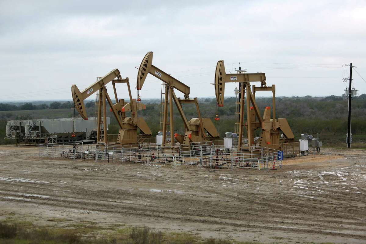 The government projects a 49,000 barrel decline next month in oil output from the Eagle Ford Shale in South Texas, where these pumpjacks worked earlier this year. ( Gary Coronado / Houston Chronicle )