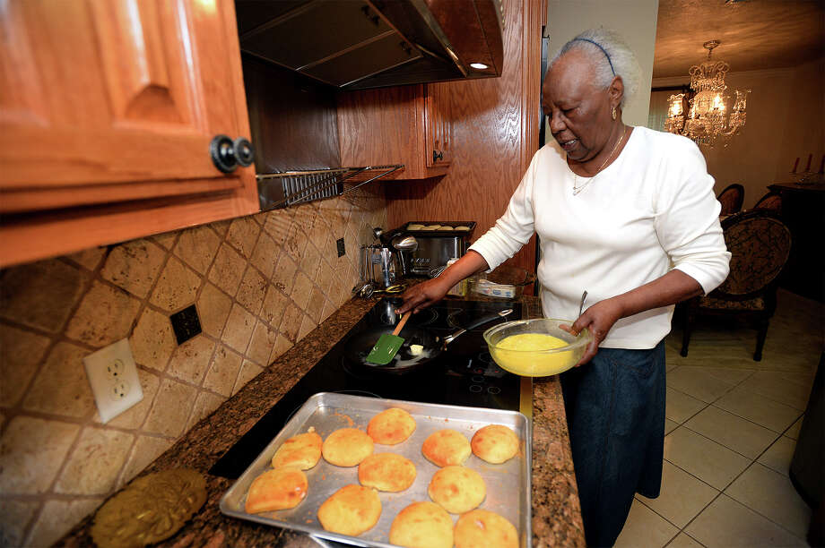 Juanita Ward cooks scrambled eggs next to a fresh batch of Jailhouse Rolls for her house guests on Friday morning. Several local peace officers were invited to Ward's home to eat the rolls she once cooked for inmates for three decades at the downtown jail.    Photo taken Friday, April 10, 2015 Guiseppe Barranco/The Enterprise Photo: Guiseppe Barranco, Photo Editor