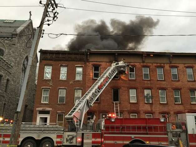 Fire strikes an apartment building near the intersection of 4th and Washington streets in Troy. (Cindy Schultz / Times Union)