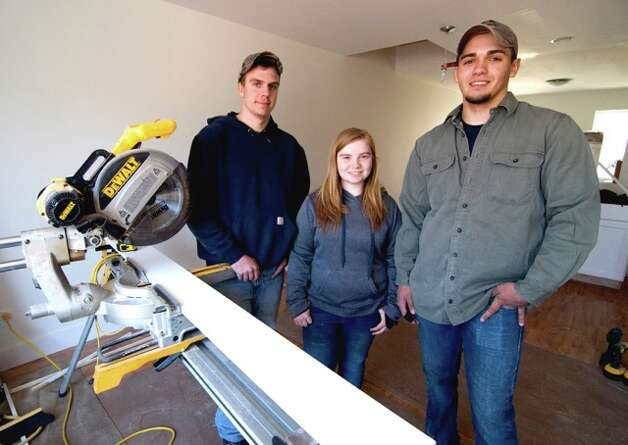 Questar III student interns and high school seniors Autumn Rose of Claverack, Brenden Lee of Greenville, at right, and Cody White of Valatie recently completed their 20-hour field internships by working at Habitat?s newest project at 210-212 Columbia St. in Hudson. (Submitted photo)