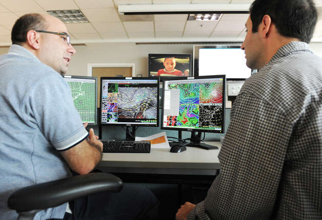 Meteorologists Tom Wasula, left, and Joe Villani work on tracking Hurricane Sandy at the National Weather Service int the CESTM building at SUNY Polytechnic Institute Thursday, Oct. 25, 2012, in Albany, N.Y.  (Lori Van Buren / Times Union archive) Photo: Lori Van Buren / 00019842A