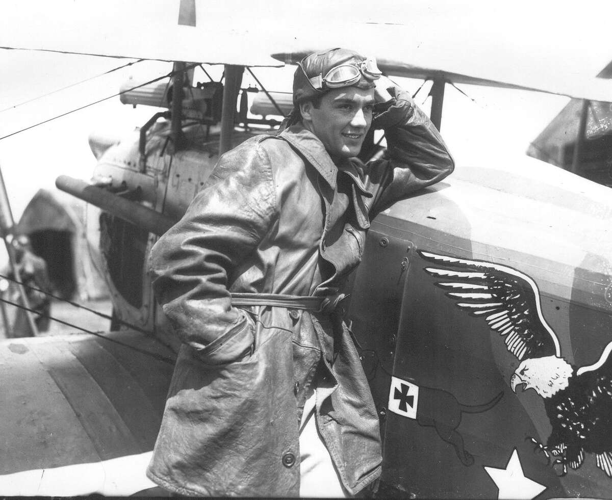 """Charles """"Buddy"""" Rogers poses beside a plane at Camp Stanley dressed as a pilot for his leading role in """"Wings."""" This photo ran in the San Antonio Light, Sept. 19, 1926."""