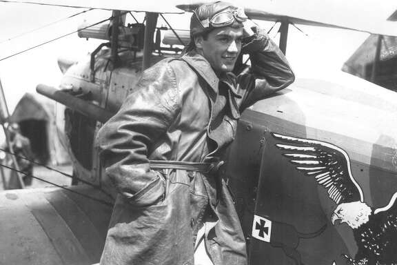 "Charles ""Buddy"" Rogers poses beside a plane at Camp Stanley dressed as a pilot for his leading role in ""Wings."" This photo ran in the San Antonio Light, Sept. 19, 1926."