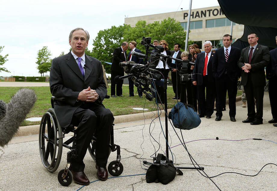 Texas Gov. Greg Abbott, who was injured in an accident years ago, uses a wheel chair. Advo cates are demanding he support a pay raise for those who attend to the disabled. Photo: San Antonio Express-News / File Photo / © 2015 San Antonio Express-News