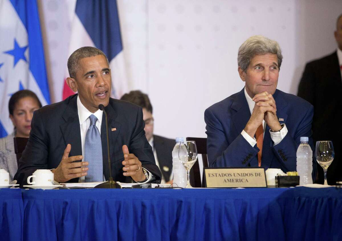 President Barack Obama, accompanied by Secretary of State John Kerry speaks during a multi-lateral meeting with Central American Integration System (SICA) Presidents, Friday, April 10, 2015, in Panama City, Panama. Obama is in Panama to attend the VII Summit of the Americas. (AP Photo/Pablo Martinez Monsivais)