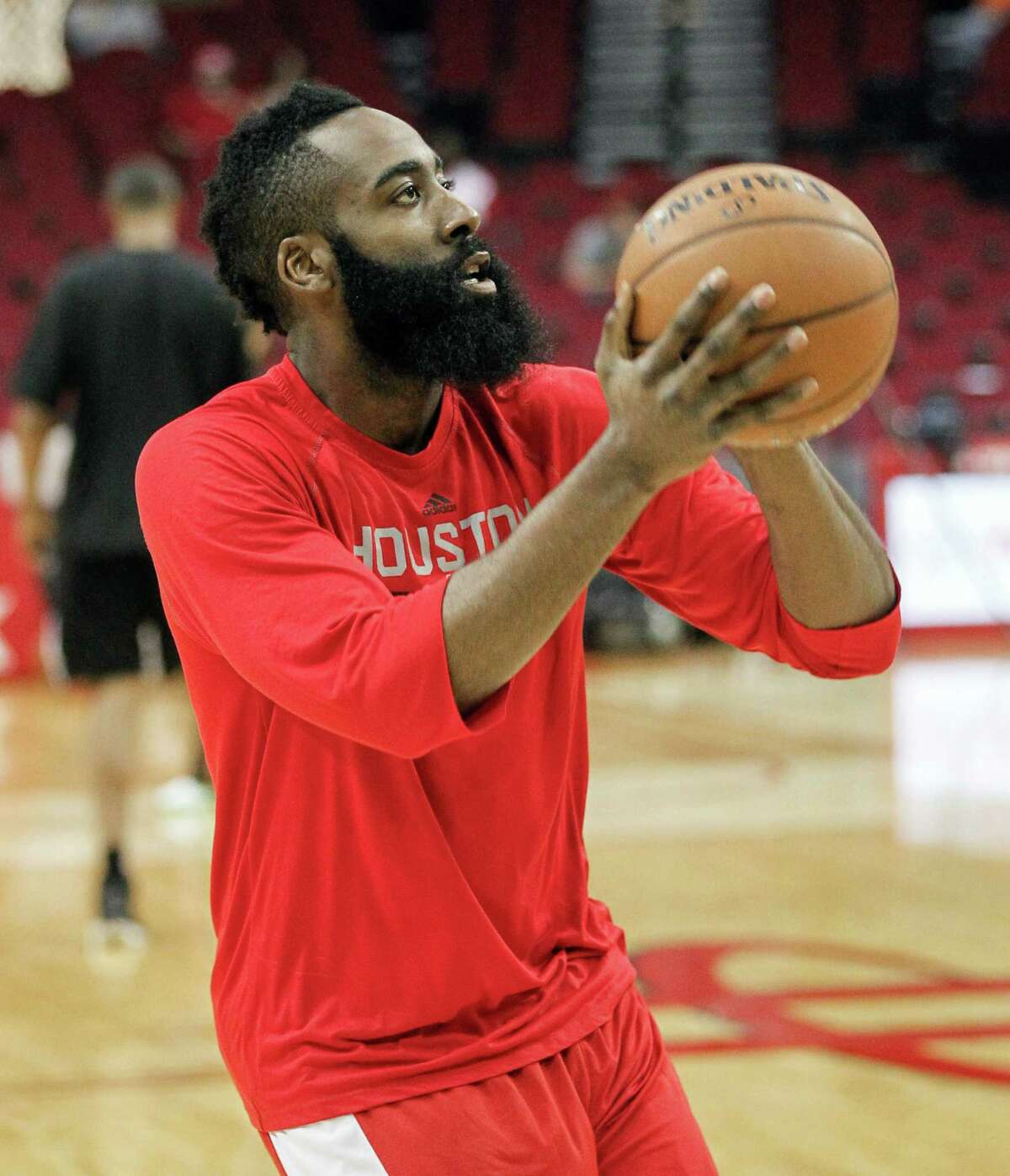 Houston Rockets' James Harden warms up before playing the San Antonio Spurs in an NBA basketball game Friday, April 10, 2015, in Houston.