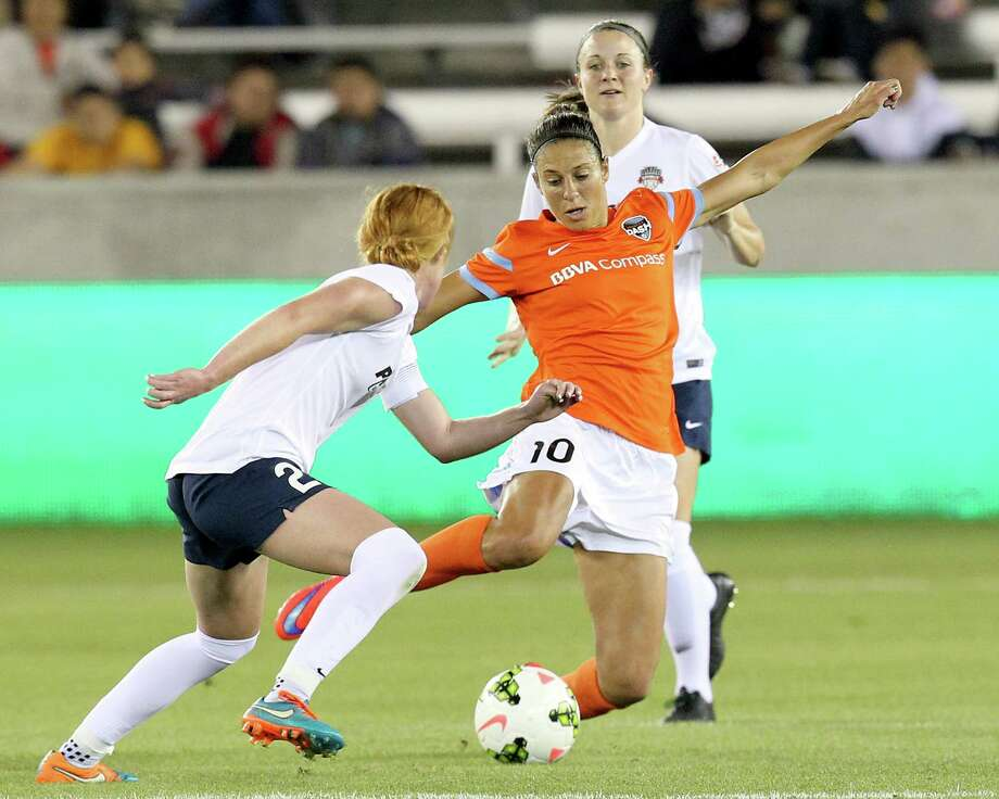 Houston Dash midfielder Carli Lloyd (10) dribbles the ball against Washington Spirit defender Victoria Huster (23) in the first half at BBVA Stadium on Friday, April 10, 2015 in Houston, TX. Photo: Thomas B. Shea, For The Chronicle / © 2015 Thomas B. Shea