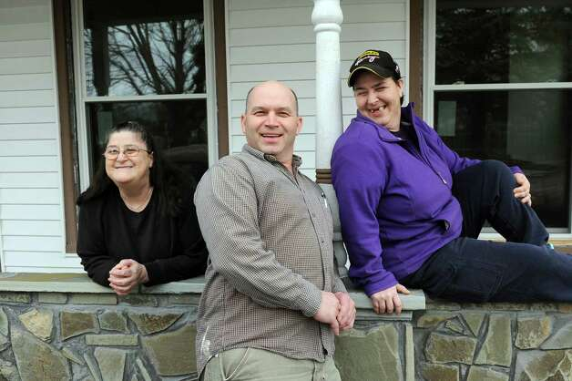 Louise Hoffman, left, joins her son Tom Hoose, center, and daughter Tammy Beers on the front porch of her home on Friday, April 10, 2015, in Catskill, N.Y. (Cindy Schultz / Times Union) Photo: Cindy Schultz / 00031387A