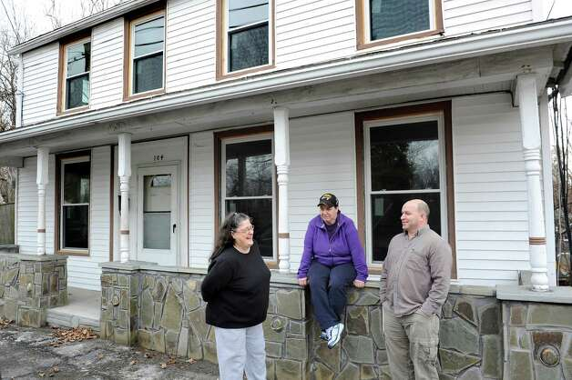 Louise Hoffman, left, joins her daughter Tammy Beers, center, and son Tom Hoose on the front porch of her home on Friday, April 10, 2015, in Catskill, N.Y. (Cindy Schultz / Times Union) Photo: Cindy Schultz / 00031387A