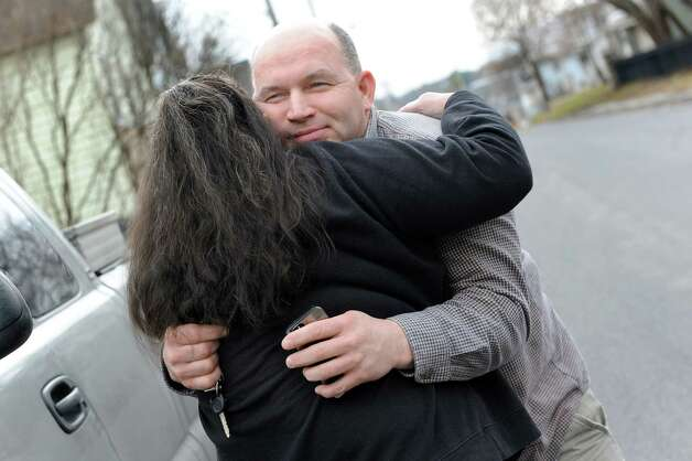 Louise Hoffman, left, hugs her son Tom Hoose when he arrives at her home on Friday, April 10, 2015, in Catskill, N.Y. (Cindy Schultz / Times Union) Photo: Cindy Schultz / 00031387A