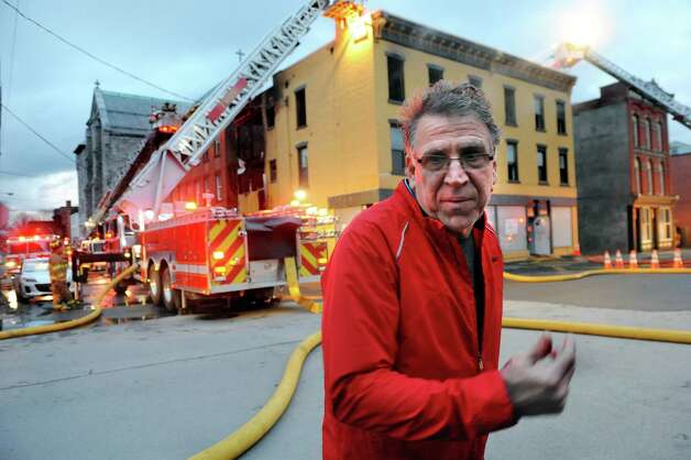 George Regan, who owns 231 and 233 4th St., in back, is on the scene of the 5-alarm fire on Friday, April 10, 2015, in Troy, N.Y. (Cindy Schultz / Times Union) Photo: Cindy Schultz / 00031404A