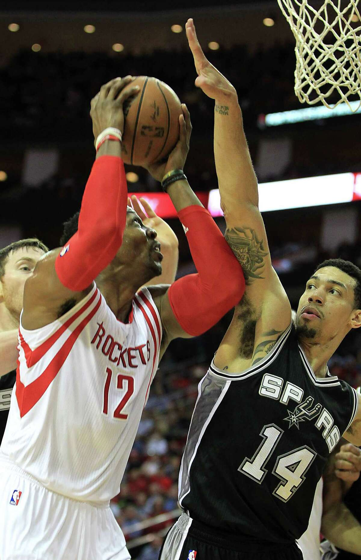 The Spurs' defense was at its swarming best when it didn't have to contend with Rockets center Dwight Howard, left. Danny Green, right, and company made life miserable for the Rockets.