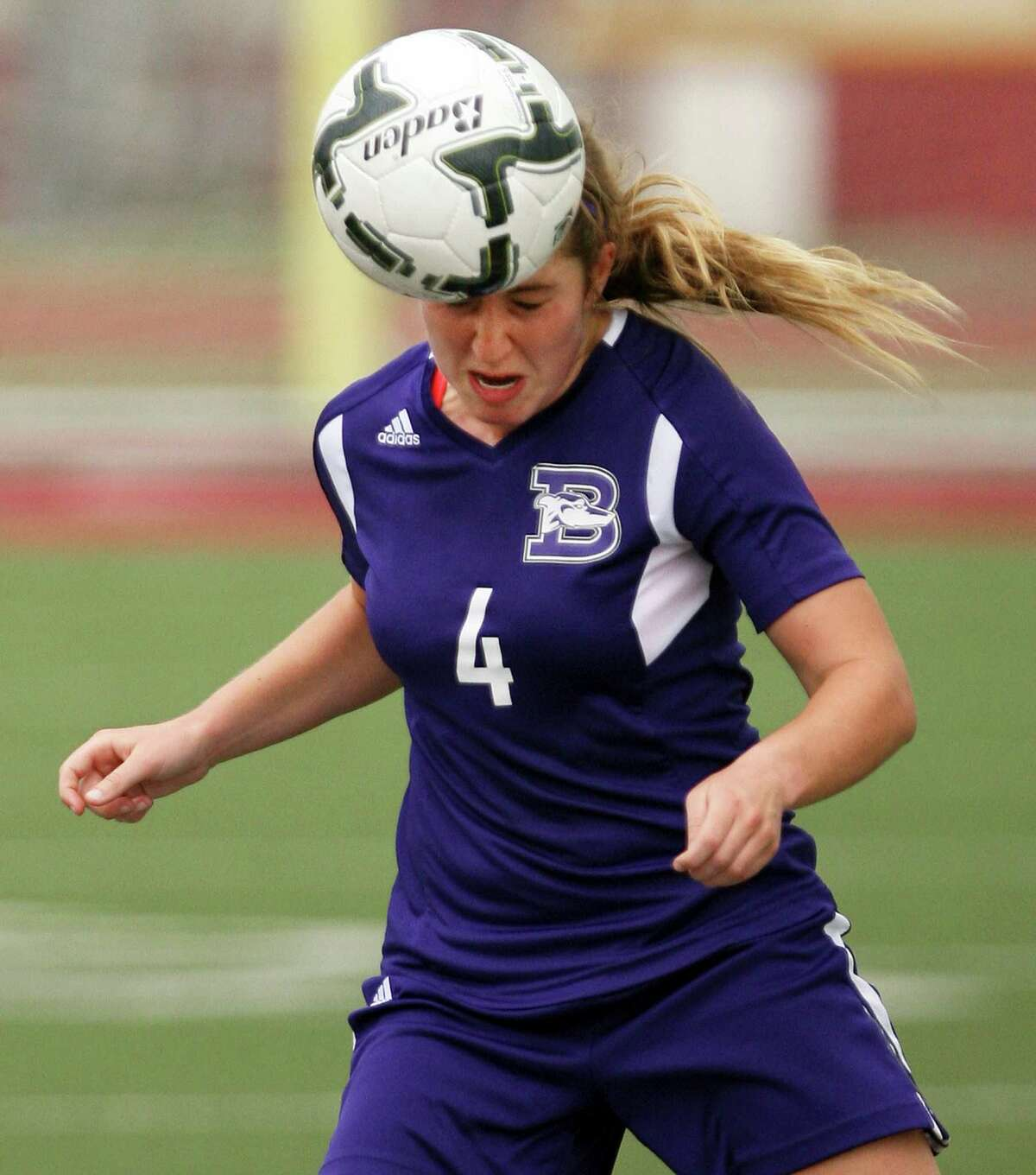 Boerne's Alexandra Chapman, 4, heads the ball in a in a 4A regional semifinal game against Kingsville April 10, 2015 in Mission.