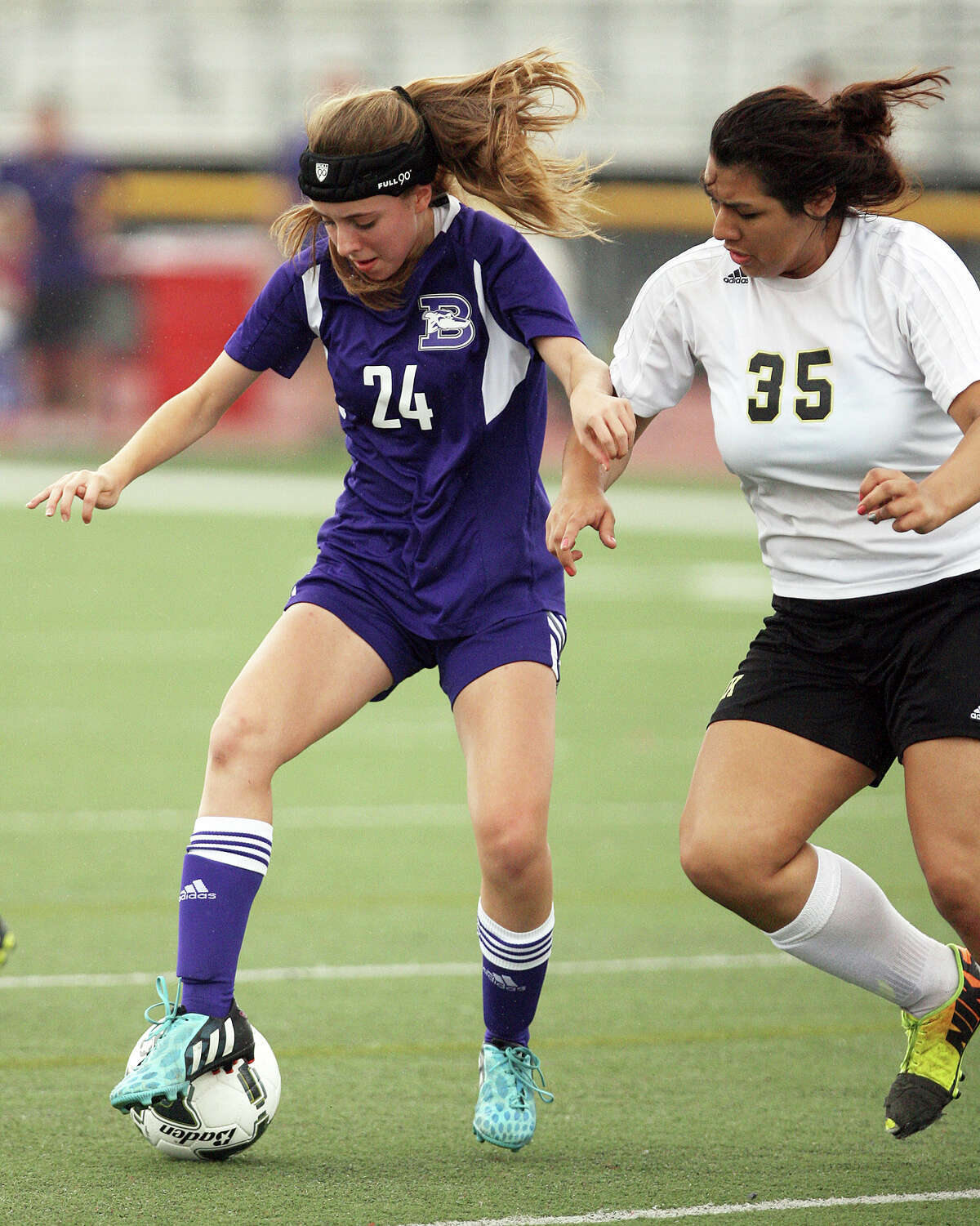 Boerne's Presley Klar, 24, and Kingsville's Mikaylah Perez, 35, battle for the ball in a in a 4A regional semifinal game April 10, 2015 in Mission.
