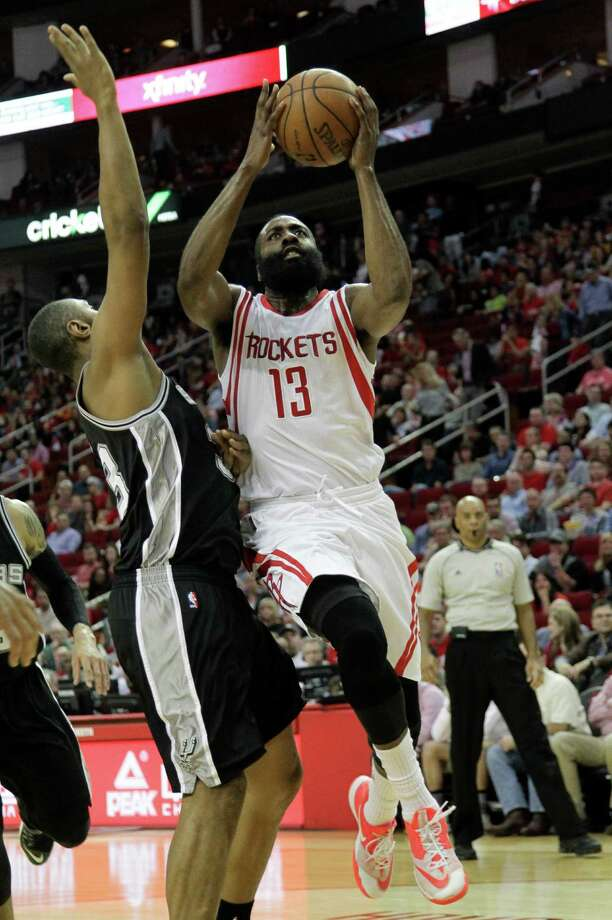 Houston Rockets guard James Harden (13) drives past San Antonio Spurs center Boris Diaw (33) for a layup during the first half of an NBA basketball game Friday, April 10, 2015, in Houston. (AP Photo/Bob Levey) Photo: Bob Levey, FRE / Associated Press / FR156786 AP