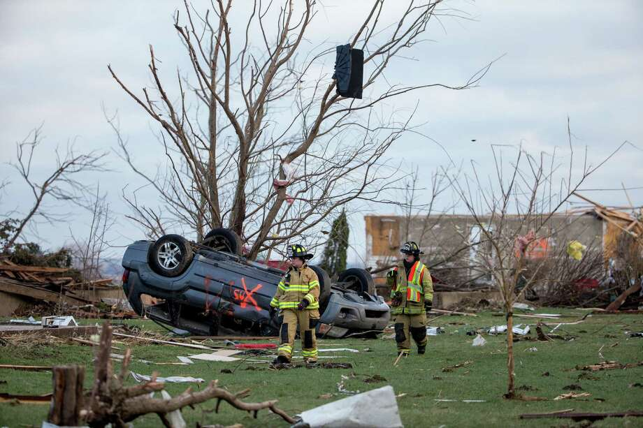 Crews in Fairdale, Ill., search through debris for unaccounted people the morning after a tornado swept through the rural town. Photo: Jon Durr /Getty Images / 2015 Getty Images