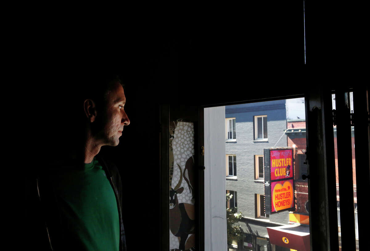 Richard Santini, a client of North Beach Citizens, checks out the group's new space in a former adult movie theater.