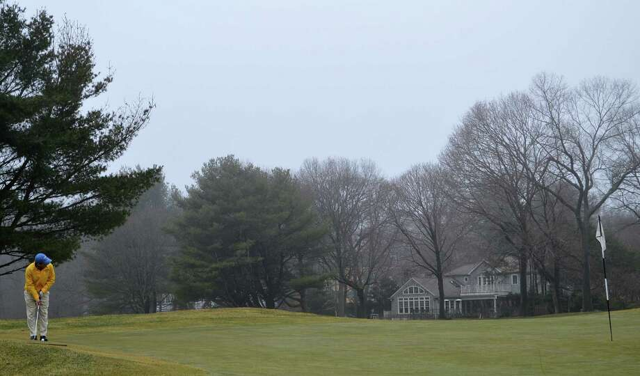 Despite misty weather, Xavier Vegas of Westport was among the golfers who hit the links Friday for the start of the season at Longshore Golf Course. Photo: Jarret Liotta / Westport News