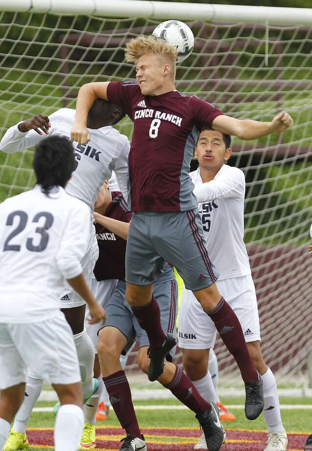 Aarstein Halderaker of Cinco Ranch gets a head on the ball as the Cougars took on Alief Elsik in the 6A Region III Soccer semi-finals at Abshier Stadium in Deer Park on April 10, 2015. Photo: Diana L. Porter, For The Chronicle / © Diana L. Porter