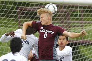 Aarstein Halderaker of Cinco Ranch gets a head on the ball as the Cougars took on Alief Elsik in the 6A Region III Soccer semi-finals at Abshier Stadium in Deer Park on April 10, 2015.