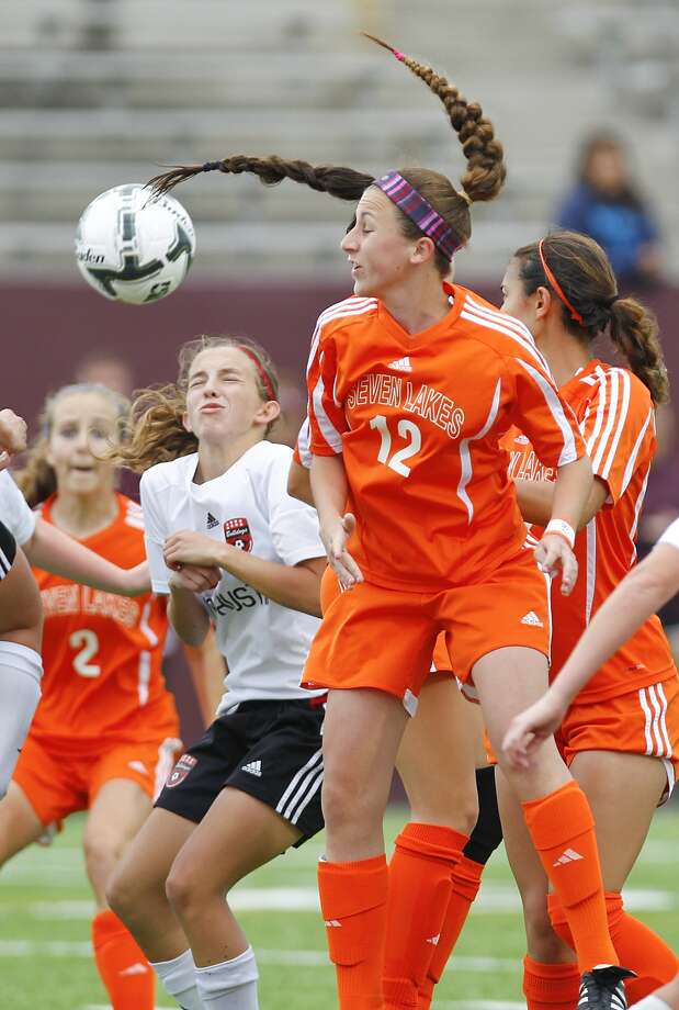 Julia Marotta of Seven Lakes gets a head on the ball as the Lady Spartans took on Ft. Bend Austin in the 6A Region III Soccer semi-finals at Abshier Stadium in Deer Park on April 10, 2015. Photo: Diana L. Porter, For The Chronicle / © Diana L. Porter