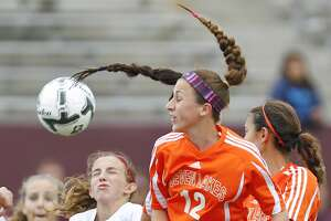 Julia Marotta of Seven Lakes gets a head on the ball as the Lady Spartans took on Ft. Bend Austin in the 6A Region III Soccer semi-finals at Abshier Stadium in Deer Park on April 10, 2015.