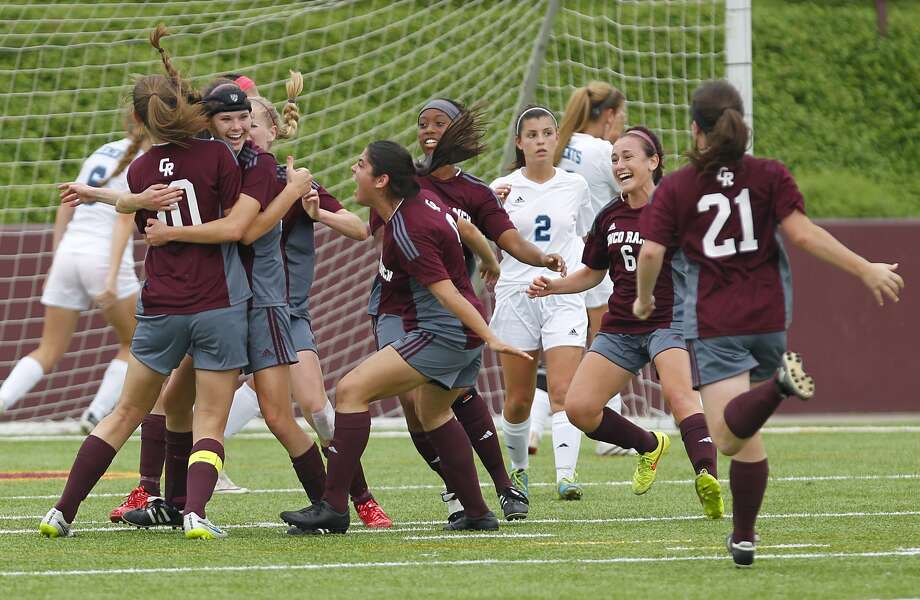 The Cinco Ranch Lady Cougars celebrate the only goal of the game by Madee Galllagher as they took on Clements in the 6A Region III Soccer semi-finals at Abshier Stadium in Deer Park on April 10, 2015. Photo: Diana L. Porter, For The Chronicle / © Diana L. Porter