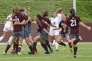 The Cinco Ranch Lady Cougars celebrate the only goal of the game by Madee Galllagher as they took on Clements in the 6A Region III Soccer semi-finals at Abshier Stadium in Deer Park on April 10, 2015.