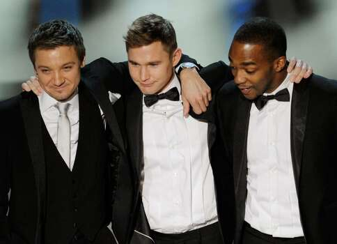 """HOLLYWOOD - MARCH 07:  Actors Jeremy Renner, Brian Geraghty and Anthony Mackie accept Best Picture award for """"The Hurt Locker"""" onstage during the 82nd Annual Academy Awards held at Kodak Theatre on March 7, 2010 in Hollywood, California.  (Photo by Kevin Winter/Getty Images) *** Local Caption *** Jeremy Renner;Brian Geraghty;Anthony Mackie Photo: Kevin Winter, Getty Images / 2010 Getty Images"""