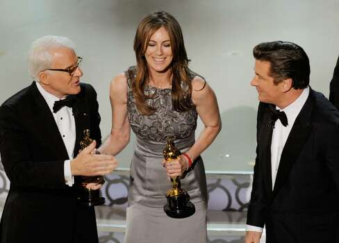 """HOLLYWOOD - MARCH 07:  Director Kathryn Bigelow (C), winner of Best Director award for """"The Hurt Locker,"""" with co-hosts Steve Martin and Alec Baldwin, onstage during the 82nd Annual Academy Awards held at Kodak Theatre on March 7, 2010 in Hollywood, California.  (Photo by Kevin Winter/Getty Images) *** Local Caption *** Kathryn Bigelow;Steve Martin;Alec Baldwin Photo: Kevin Winter, Getty Images / 2010 Getty Images"""