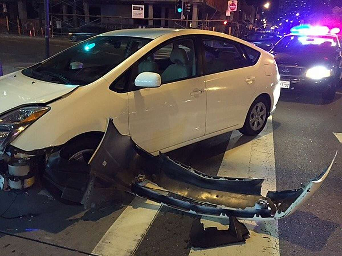This car was hit by robbery suspects who were fleeing from police at 8th and Harrison in San Francisco, on Friday, April 10, 2015. The driver and passenger were not seriously injured.