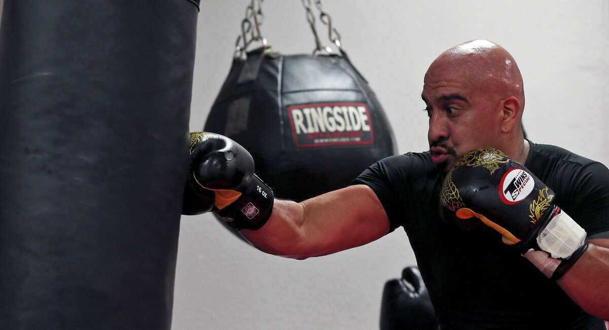 Alex Rincon, 35, hits the heavy bag during a Strike Fit class at Battle Tactics Academy.