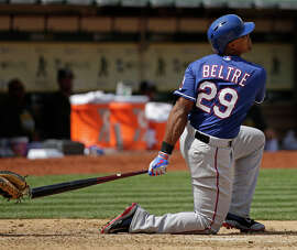 Despite going to one knee, the Rangers' Adrian Beltre hit a home run off A's reliever Evan Scribner in the seventh inning of Texas' 10-1 win on Thursday.