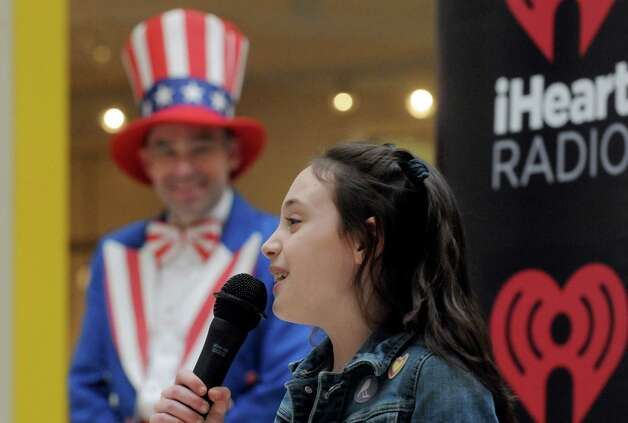 Eight-year-old Ella Gendron of Cohoes takes part in the Tri-City ValleyCats 5th Annual National Anthem tryouts at Crossgates Mall on Saturday April 11, 2015 in Guilderland , N.Y. The top performance will have the opportunity to perform the National Anthem at a premium fireworks night at Joseph L. Bruno Stadium, in front of an average of 5,000 fans. (Michael P. Farrell/Times Union) Photo: Michael P. Farrell / 00031172A