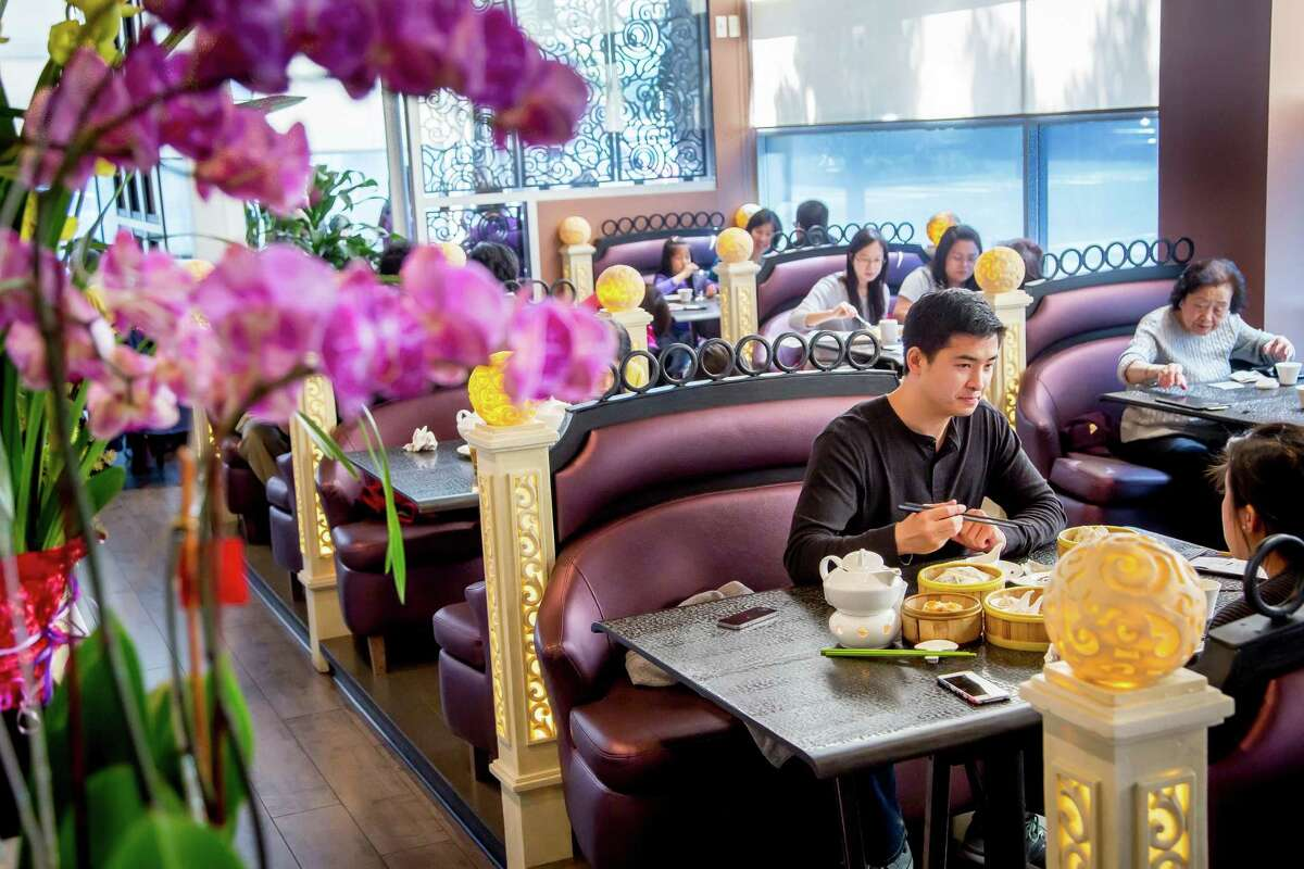 People dine on dim sum at Dragon Beaux in San Francisco.