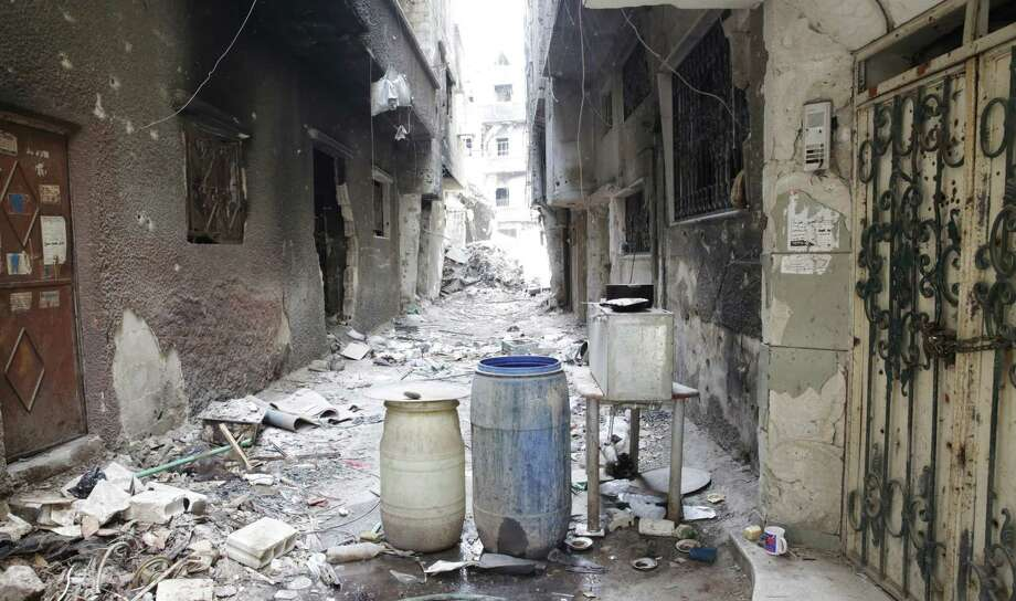 A deserted street in the Yarmouk refugee camp outside Damascus, Syria, shows heavy damage. Islamic State fighters overran much of the camp last week. Photo: /Associated Press / AP