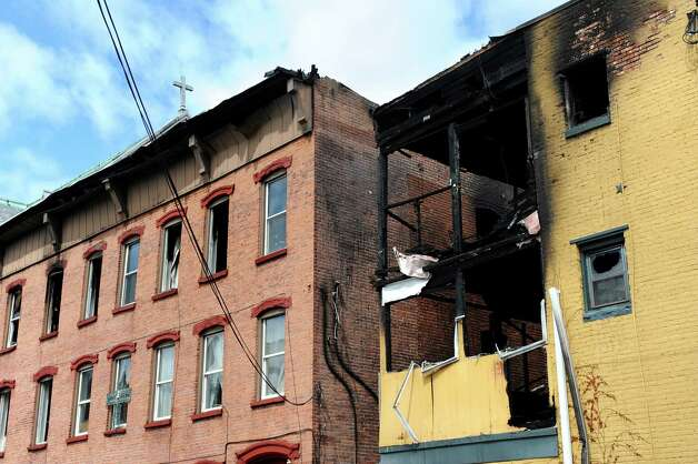 Buildings on 4th and Washington streets on Saturday, April 11, 2015, in Troy, N.Y. The two buildings were heavily damaged by a fire on Friday. (Cindy Schultz / Times Union) Photo: Cindy Schultz