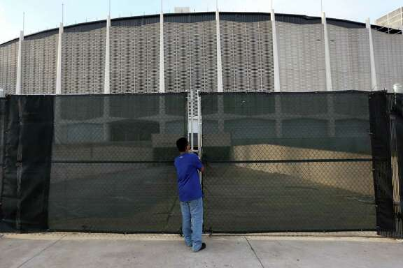 Carlos Chavez, 11, of Houston, takes a peak at the dome at the 50th anniversary of the opening of the Harris County Domed Stadium, better known as the Astrodome, during a free, fun birthday festivities Thursday, April 9, 2015, in Houston, Texas. ( Gary Coronado / Houston Chronicle )