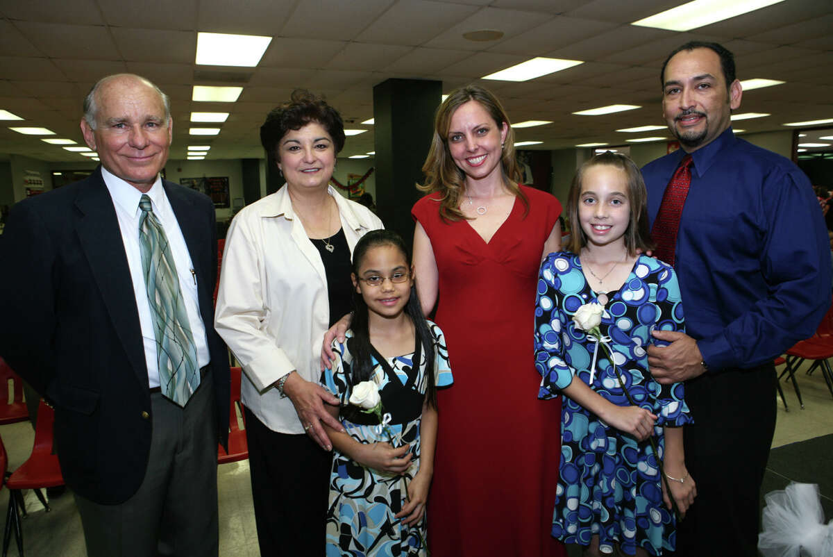 Eliseo Cadena, Olga Hernandez (board members), Amanda Contreras (student), Angela Dominguez (principal), Jordan Hernandez (student) and Alex Hernandez (dad) were at the Young Women's Leadership Academy's ceremony on 5/21/2008 at Fox Tech HS. names checked photo by leland a. outz