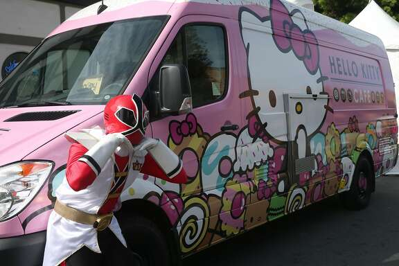 Power Rangers are fans of the Hello Kitty Cafe food truck at the 48th annual Cherry Blossom Festival in Japantown in San Francisco, Calif. on Saturday, April 11, 2015.