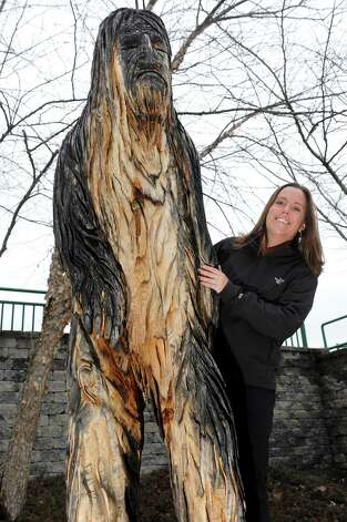 Holly Rabideau, president of the Whitehall Chamber of Commerce, with the statue of Bigfoot on Thursday, April 9, 2015, at Skenesborough Park in Whitehall, N.Y. (Cindy Schultz / Times Union) Photo: Cindy Schultz / 00031372A
