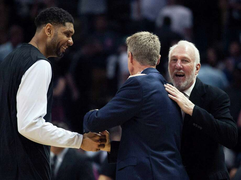 San Antonio Spurs head coach Gregg Popovich, right, and Spurs forward Tim Duncan, left, speak to Golden State Warriors head coach Steve Kerr after an NBA basketball game, Sunday, April 5, 2015, in San Antonio. San Antonio won 107-92. (AP Photo/Darren Abate) Photo: Darren Abate, FRE / Associated Press / FR115 AP