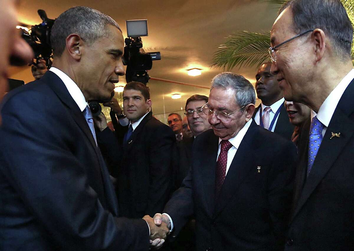 President Barack Obama and Cuban President Raúl Castro meet before the opening ceremony of the Summit of the Americas in Panama City.