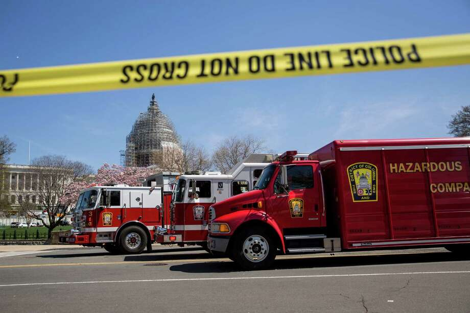WASHINGTON, DC - APRIL 11: District of Columbia fire and hazardous materials truck sit parked outside the west front of the U.S. Capitol on Capitol Hill, April 11, 2015 in Washington, DC.  According to the U.S. Capitol Police, the Capitol was on lockdown after shots were fired and a suspicious package was investigated. According to the U.S. Capitol Police, a person suffered a self-inflicted gunshot wound. (Photo by Drew Angerer/Getty Images) Photo: Drew Angerer, Stringer / Getty Images / 2015 Getty Images