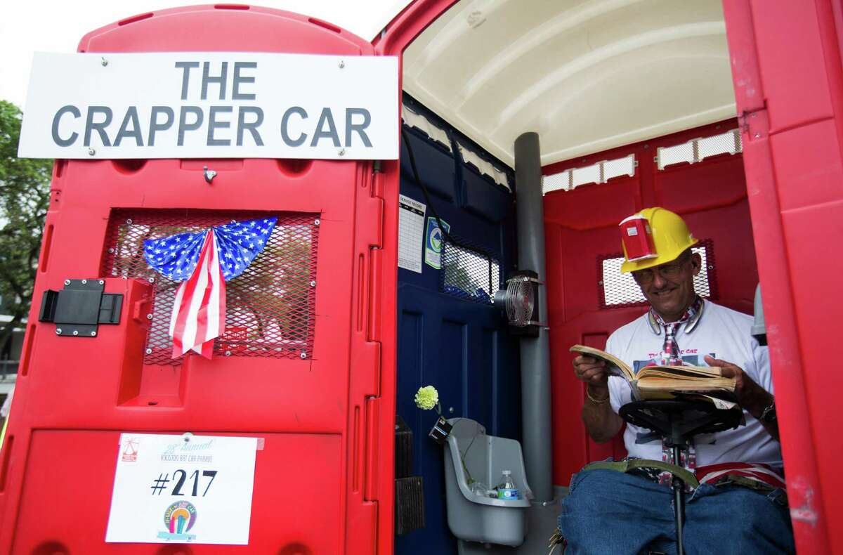 The parade attracted colorful entries like The Crapper Car, by Richard Simcik of Waco.